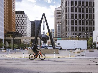 Cityscape with Detroit Slow Roll founder Jason Hall riding Super Commuter+