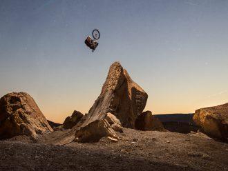 Brett Rheeder in the air after hitting a feature