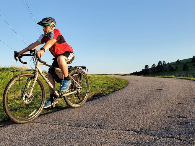 11-year-old Bodhi Linde riding a Trek 920 on a rural road.