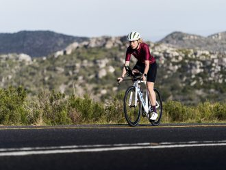 Triathlete riding on road
