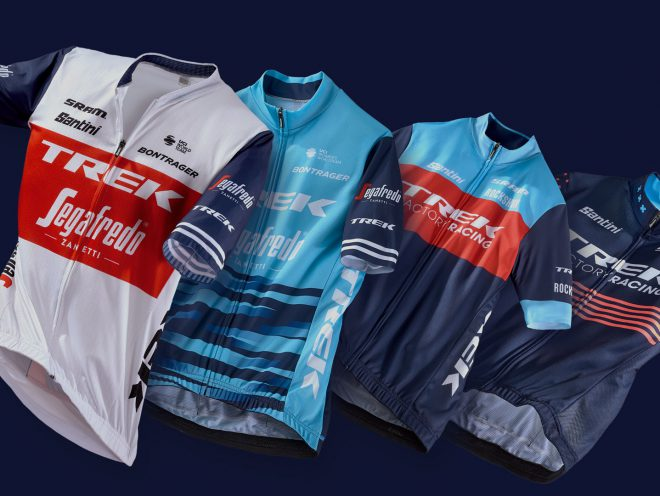 New Trek team jerseys displayed on a dark background.