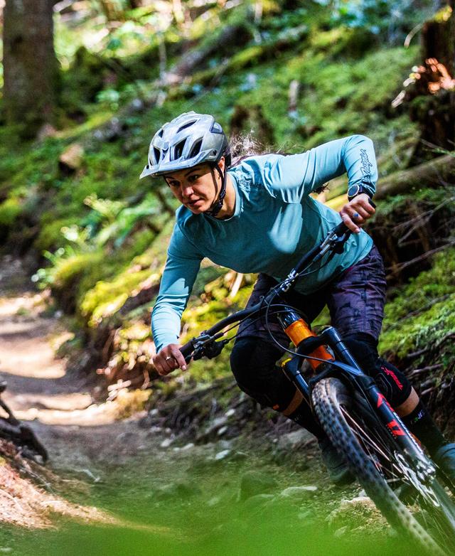 Christina Chappetta riding towards the camera on a mountain bike