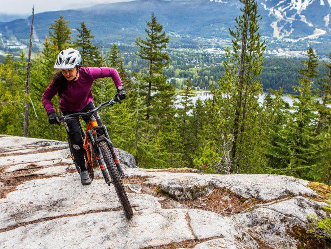 Christina Chappetta pedaling on top of a rocky climb
