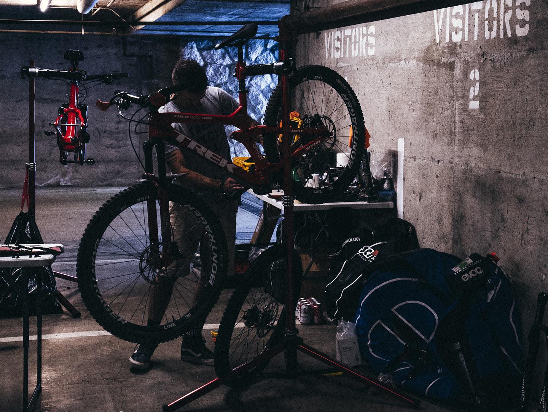 mechanic works on bike in shop