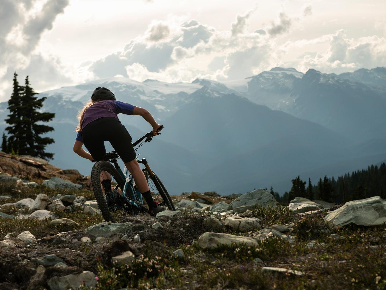 Rider climbs rocky trail