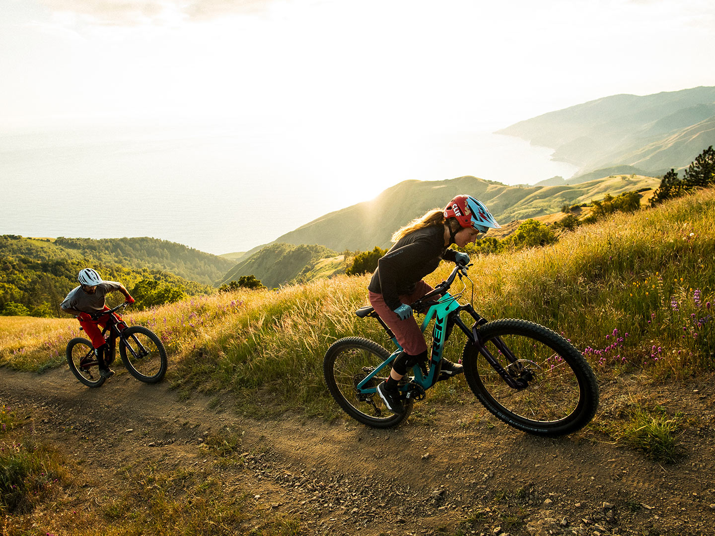 Two riders push up a steep climb