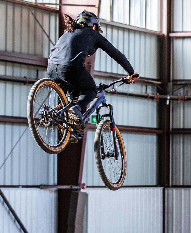 Christina Chappetta jumps on dirt jump